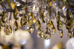 Chrystal chandelier close-up. Glamour background with copy space. Vintage crystal lamp details