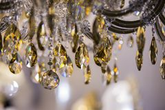 Chrystal chandelier close-up. Glamour background with copy space. Vintage crystal lamp details.  Royalty Free Stock Images