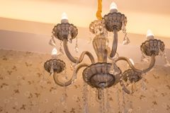 Chrystal chandelier lamp on the ceiling in Dining room stock photography