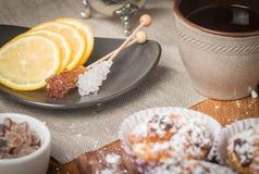 chrystal sugar with lemon and tea Royalty Free Stock Image