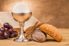 Chrystian holy communion. Composition on wooden table Royalty Free Stock Images