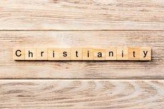 Chrystianizmu słowo pisać na drewnianym bloku chrześcijaństwo tekst na stole, pojęcie fotografia stock