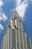 Chrystler Building against blue sky Stock Photos