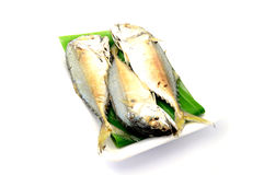 Chub mackerel on a banana leaf. Isolate on white background Royalty Free Stock Photos