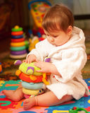 Chubby baby in bathrobe Royalty Free Stock Images