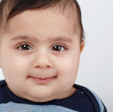 Chubby baby boy. Little baby boy with big dark eyes looking at the camera Royalty Free Stock Photo