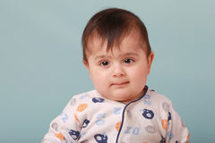 Chubby baby boy. A big chubby boy looking innocent Stock Photography