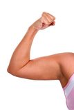 Chubby Biceps Woman. Biceps muscle of chubby woman flexing royalty free stock image