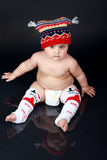 Chubby boy. Chubby baby wearing I love milk leggings Stock Images