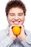 Chubby boy and orange. Happy chubby man with orange, isolated on white Stock Images
