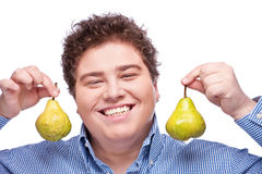 Chubby boy and pear Stock Photography
