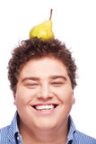 Chubby boy and pear Stock Photo