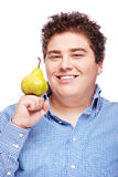 Chubby boy and pear Stock Image