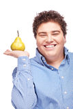 Chubby boy and pear Stock Images