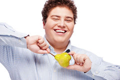 Chubby boy and pear Royalty Free Stock Photo