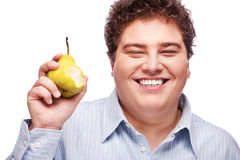 Chubby boy and pear Royalty Free Stock Photos