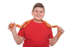 Chubby boy with sausage. Isolated on white Stock Photography