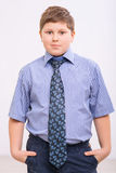 Chubby boy is standing with hands in pockets Royalty Free Stock Photography