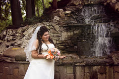 Chubby bride posing Stock Images