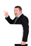 Chubby businessman pointing Royalty Free Stock Photography