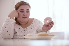 Chubby charming woman taking care of her health Stock Images