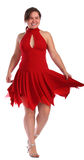Chubby girl in red dress dancing Stock Photo