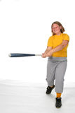 Chubby girl swinging softball bat. Chubby girl in yellow swinging softball bat royalty free stock photography