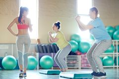 Fitness with step-platforms royalty free stock image