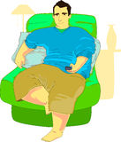 Chubby Guy Browsing TV. Chubby guy sitting on a stuffed armchair browsing TV in his living room Stock Image