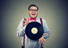 Eccentric man excited with vinyl disk stock image
