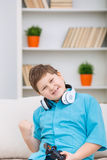 Chubby kid cheering after a video game Royalty Free Stock Image