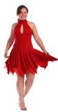 Chubby Mädchen im roten Kleidtanzen Stockfoto
