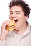 Chubby man and food. Cute chubby eating a hamburger, isolated on white Stock Photo