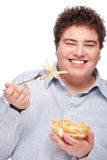 Chubby man with French fries Royalty Free Stock Photo