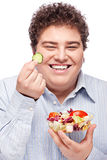 Chubby man with fresh salad Royalty Free Stock Photo