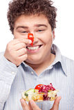 Chubby man with fresh salad Royalty Free Stock Photos