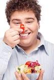 Chubby man with fresh salad Royalty Free Stock Photos