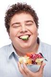 Chubby man with fresh salad Stock Image