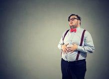 Chubby man having indigestion problem royalty free stock photography
