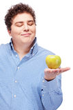 Chubby man holding apple Royalty Free Stock Photo