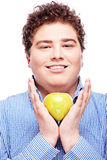 Chubby man holding apple Royalty Free Stock Photography