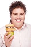 Chubby man holding apple and hamburger Royalty Free Stock Image