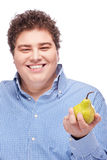 Chubby man holding pear Royalty Free Stock Images