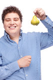 Chubby man holding pear Stock Photos