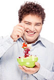Chubby man and salad. Happy young chubby man with fresh salad in dish, isolate on white Royalty Free Stock Photos