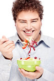 Chubby man and salad. Happy young chubby man with fresh salad in dish, isolate on white Stock Photography