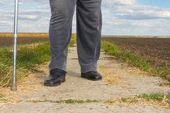 Chubby man with walking stick Royalty Free Stock Photos