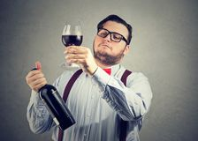 Snobby wine expert exploring drink stock photography