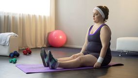 Chubby motivated girl doing sport exercises for being healthy and slim, workout royalty free stock photos