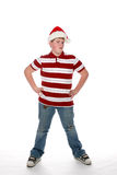Chubby teenage boy in striped shirt and santa hat Royalty Free Stock Photography